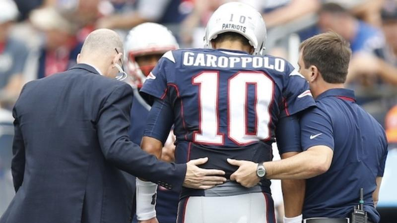 patriots-roller-coaster-day-turns-on-jimmy-garoppolos-performance-injury-1474236128