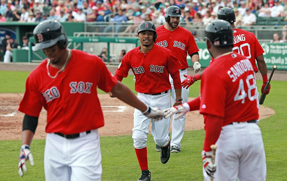 (Fort Myers, FL, 02/23/17) Boston Red Sox shortstop Xander Bogaerts, right fielder Mookie Betts, first baseman Mitch Moreland, third baseman Pablo Sandoval and left fielder Chris Young celebrates Morelands three run homer in the third inning during Spring Training game against Northeastern University on Thursday, February 23, 2017  Staff photo by Matt Stone
