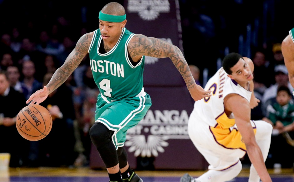Boston Celtics guard Isaiah Thomas, left, steals the ball away from Los Angeles Lakers guard Jordan Clarkson during the first half of an NBA basketball game in Los Angeles, Sunday, Feb. 22, 2015. (AP Photo/Chris Carlson)