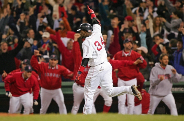 BOSTON - OCTOBER 17:  David Ortiz #34 celebrates after hitting the game winning two-run home run against the New York Yankees in the twelfth inning during game four of the American League Championship Series on October 17, 2004 at Fenway Park in Boston, Massachusetts.  (Photo by Ezra Shaw/Getty Images) *** Local Caption *** David Ortiz